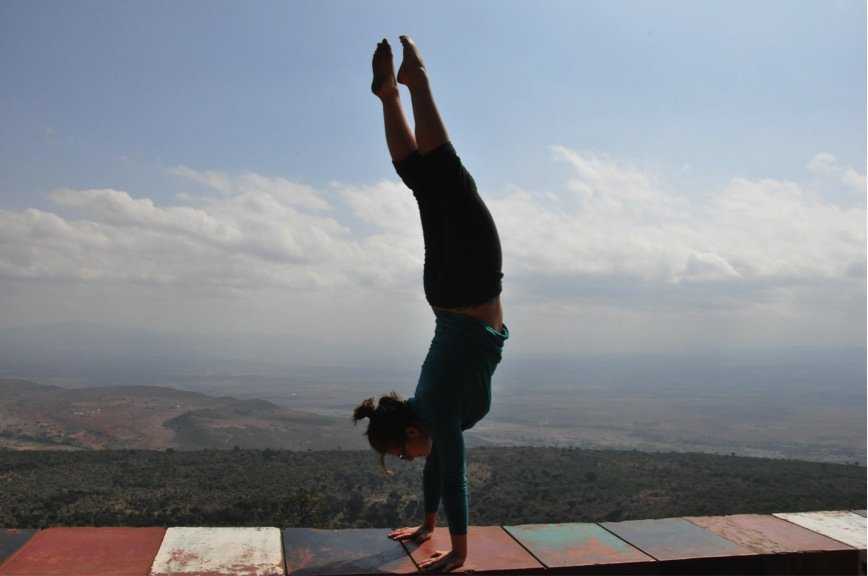 Michaela does a hand stand over Rift Valley