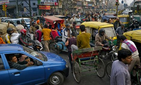 Driving to distraction. A rush-hour traffic jam in the old city of Delhi is complicated by one of a proliferation of new small cars.